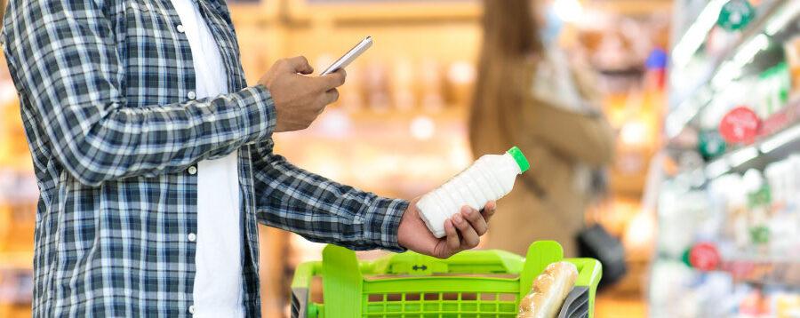 Man scanning an item at a supermarket